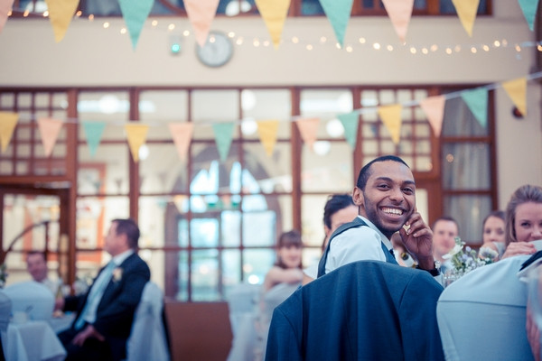 Wedding guest smiling as he listens to speech