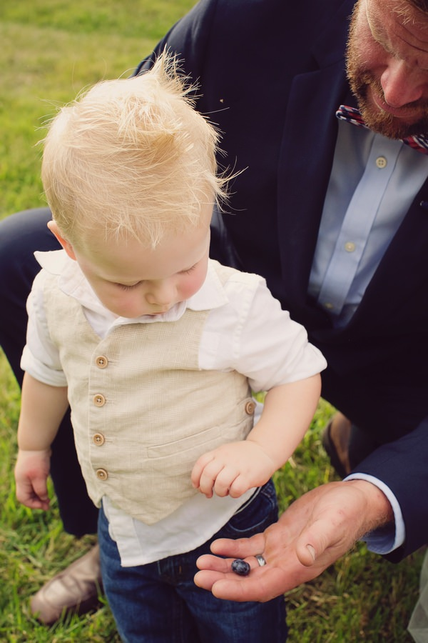 Groom giving pageboy blueberry