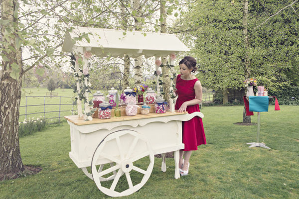 Bride at vintage carnival sweet cart