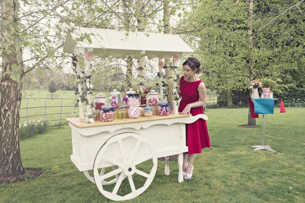 Bride at vintage carnival sweet cart