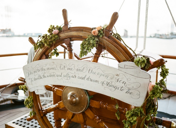 Wheel of the Tall Ship Elissa with flowers