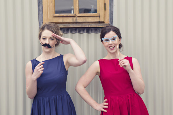 Vintage brides with prop moustache and glasses