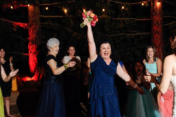 Happy lady just caught bride's bouquet