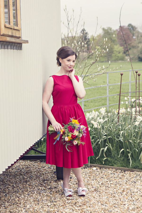 Bride in red vintage wedding dress holding bouquet