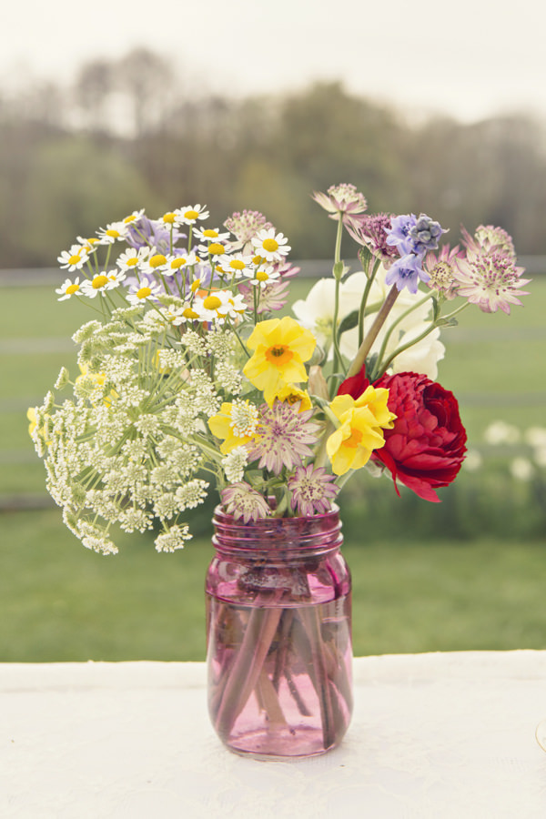 Wedding flowers in pink glass vase