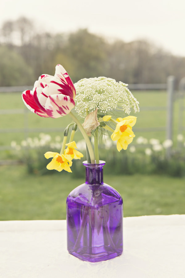 Wedding flowers in purple glass vase