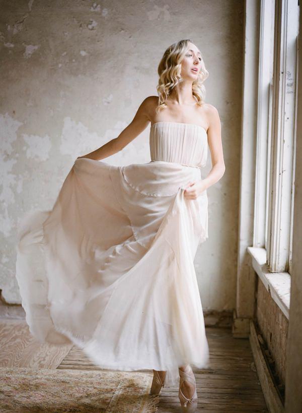 Ballerina bride holding up skirt
