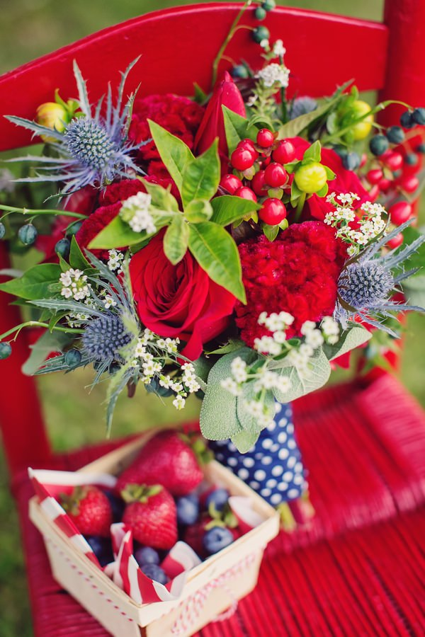 Red bridal bouquet and strawberries