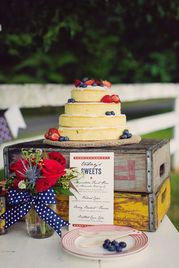 Naked wedding cake displayed on crates