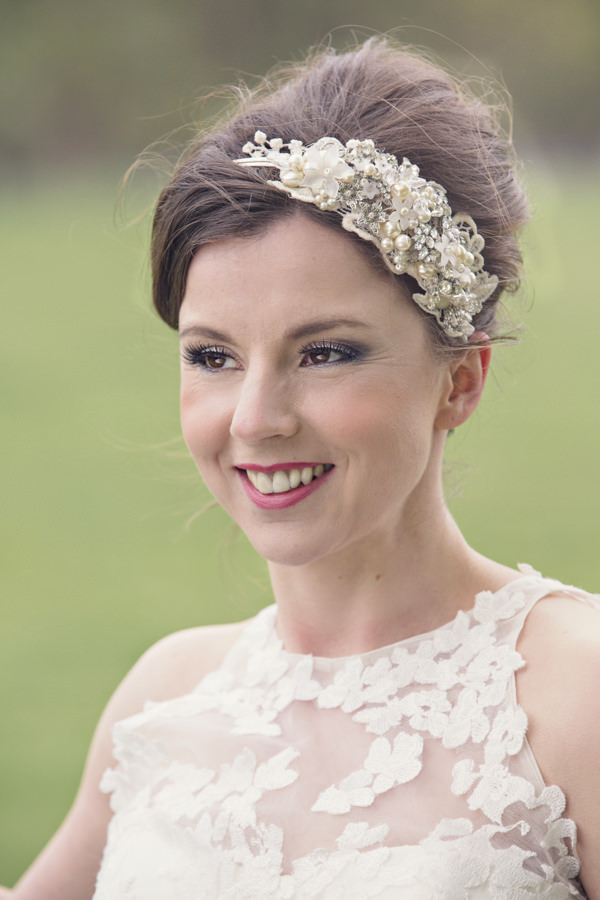 Bride with lace headpiece and detail on dress