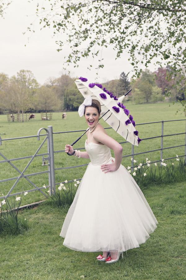Bride holding parasol