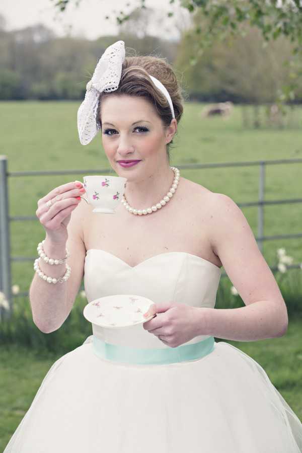 Bride with vintage cup and saucer