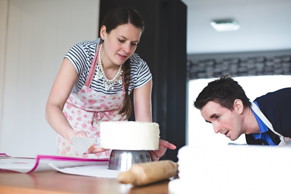 Couple icing a cake