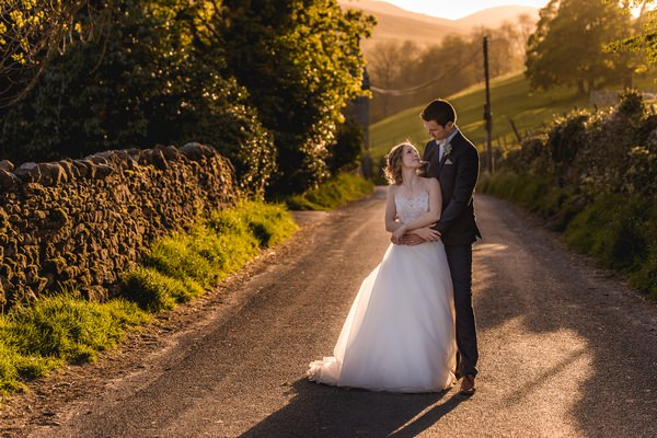 Bride and groom in road - Picture by Andrew Keher Photography