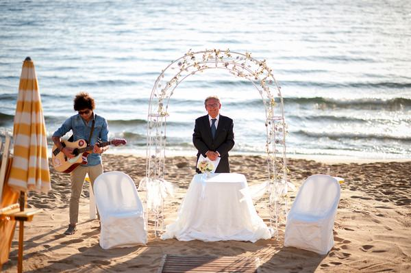 Wedding ceremony arch on beach in Italy