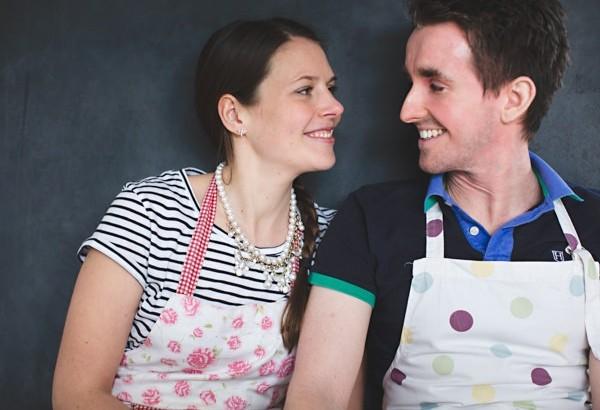 Couple wearing baking aprons