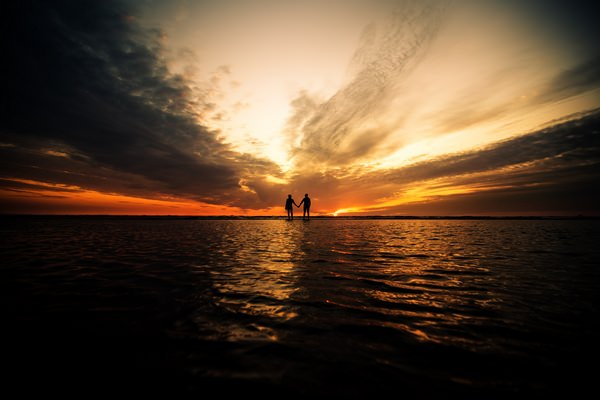 Silhouette of couple appearing to stand on water - Picture by Andrew Keher Photography