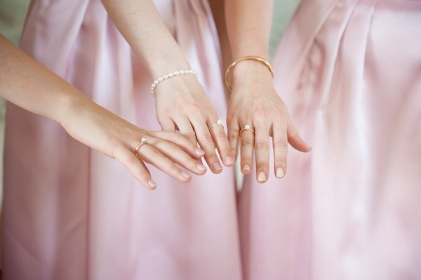 Bridesmaids showing rings on hands
