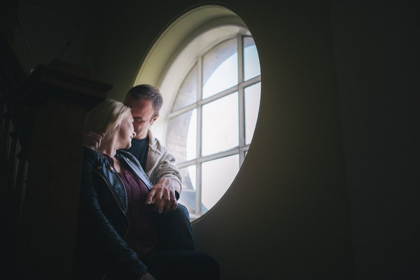 Couple sitting by round window in Middlesbrough Reference Library