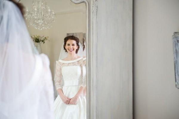 Bride looking in mirror