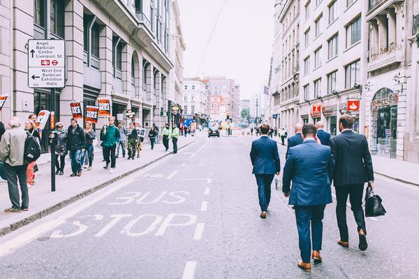 Groomsmen walking down road in London