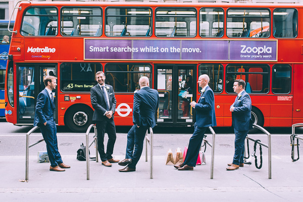 Groomsmen in London with bus going past