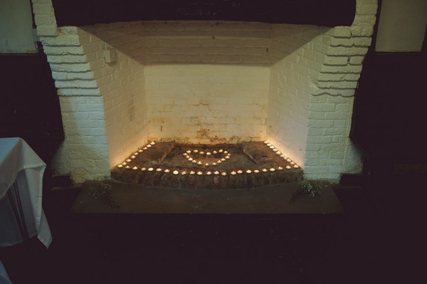 Shape of heart in candles in fireplace