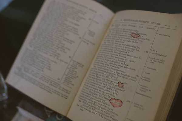 Words in book circled with hearts