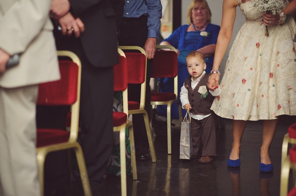 Toddler pageboy walking down aisle