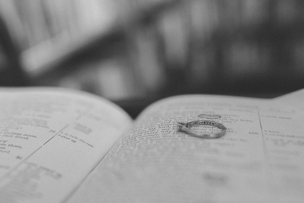 Engagement rings on book