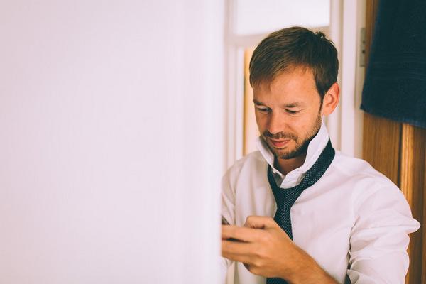Groom looking at phone