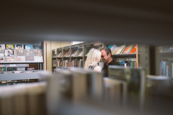 Couple seen through shelf in Middlesbrough Reference Library