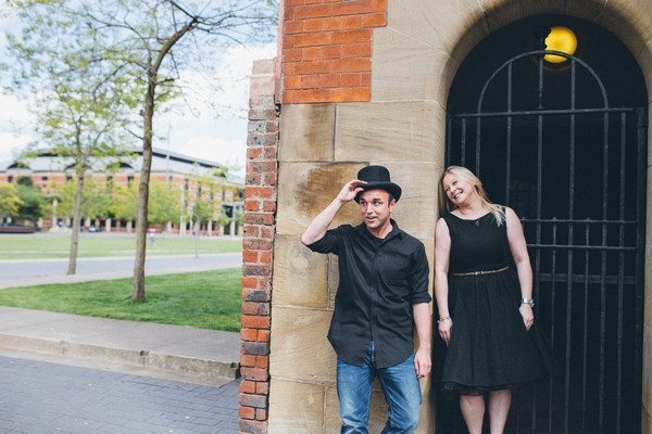 Woman with man in top hat outside Middlesbrough Reference Library