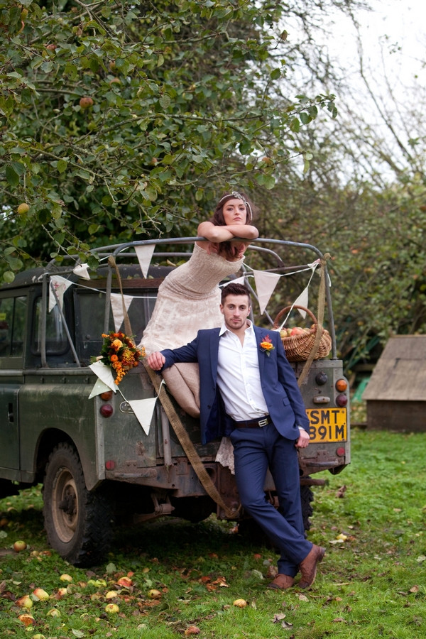 Bride and groom on back of Land Rover at Deer Park