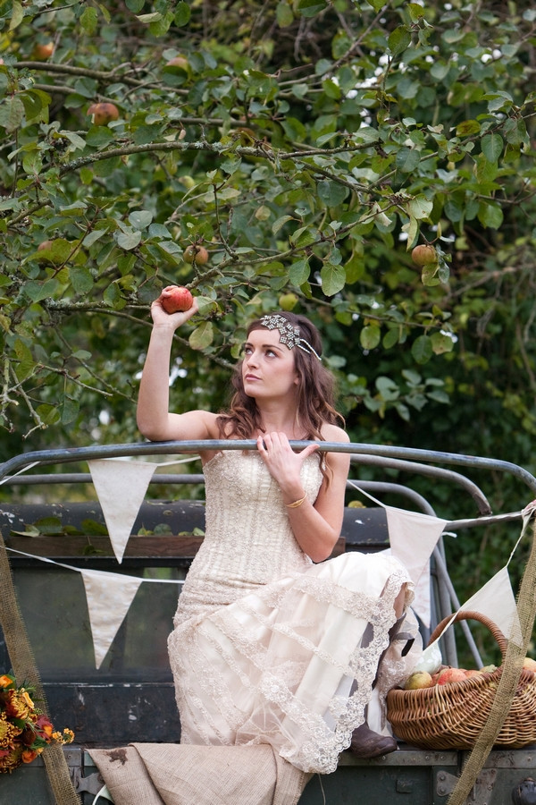 Bride picking apple from tree