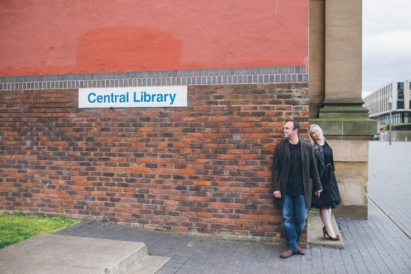 Couple standing against wall of Middlesbrough Reference Library