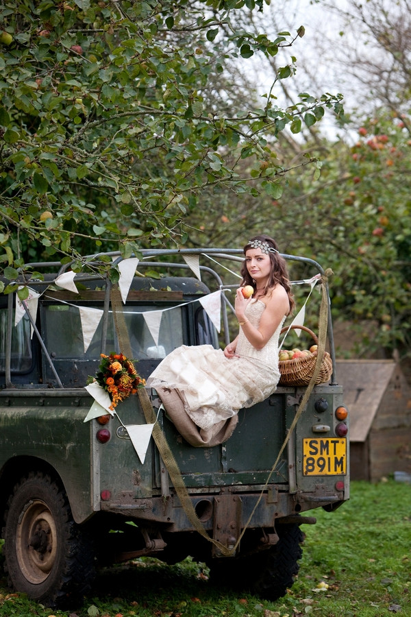 Bride on back of Land Rover