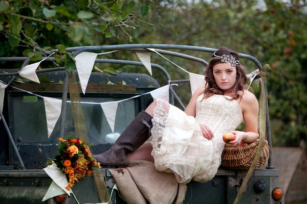 Bride laying across back of Land Rover