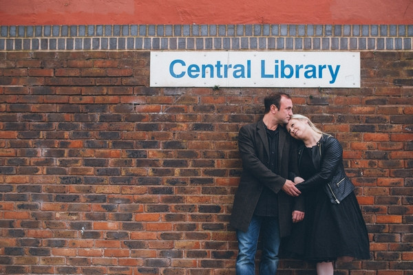 Woman leaning on man outside Middlesbrough Reference Library
