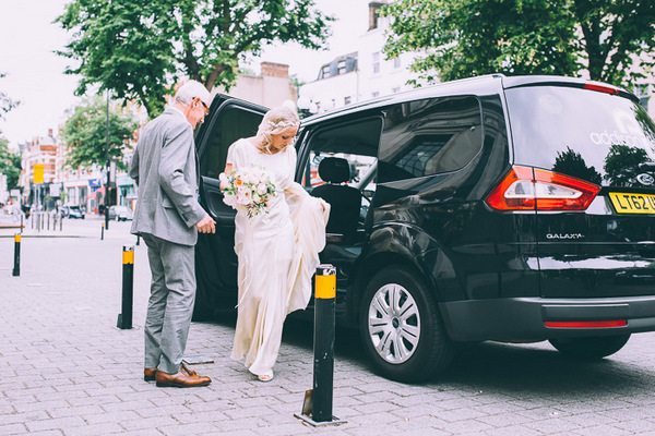 Bride getting out of black cab