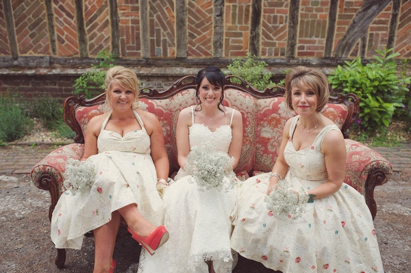 Bride and bridesmaids sitting on couch