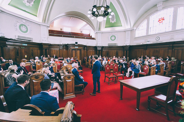 Groom waiting for bride in Islington Town Hall