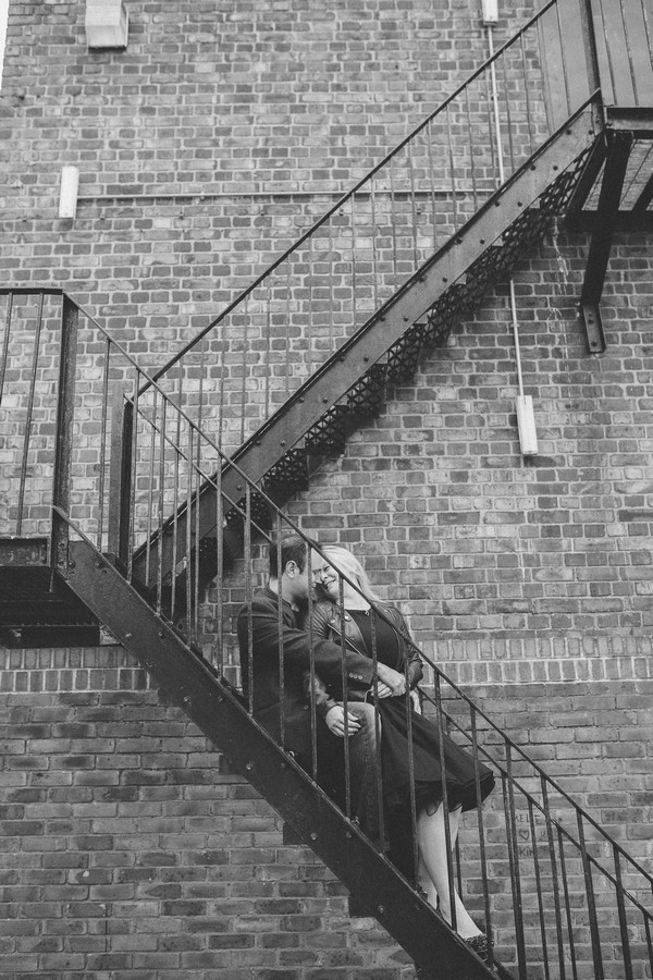 Couple sitting on metal staircase