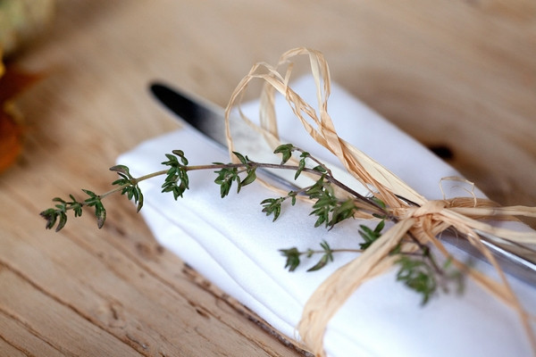 Knife wrapped in string with thyme