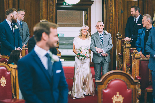 Father walking bride down aisle at Islington Town Hall
