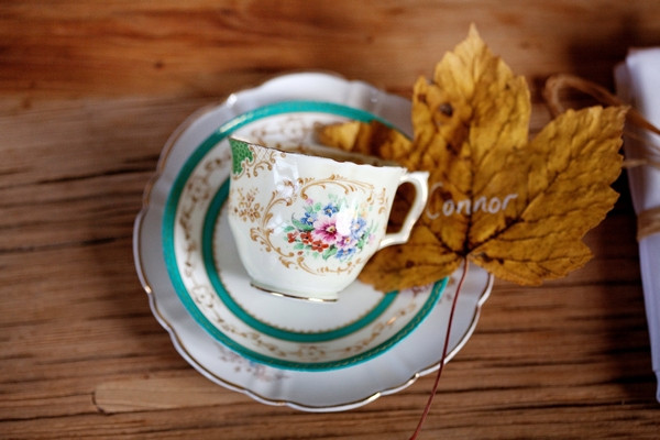 Teacup and autumn leaf on wedding table
