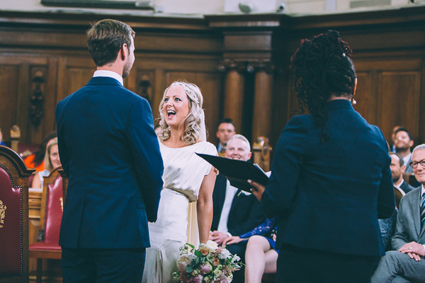 Bride laughing during wedding ceremony at Islington Town Hall