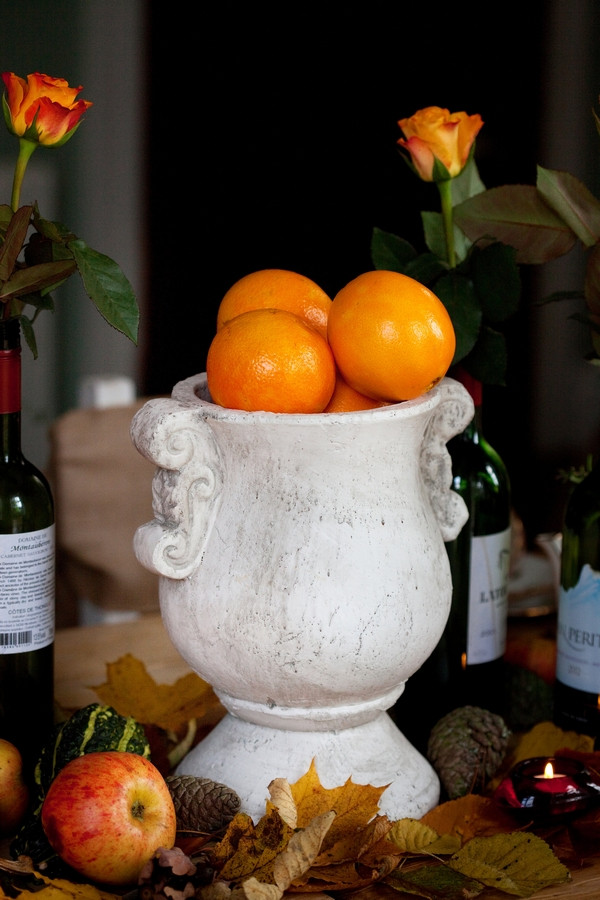 Vase of oranges