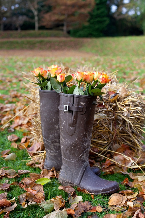 Wellington boots full of wedding flowers