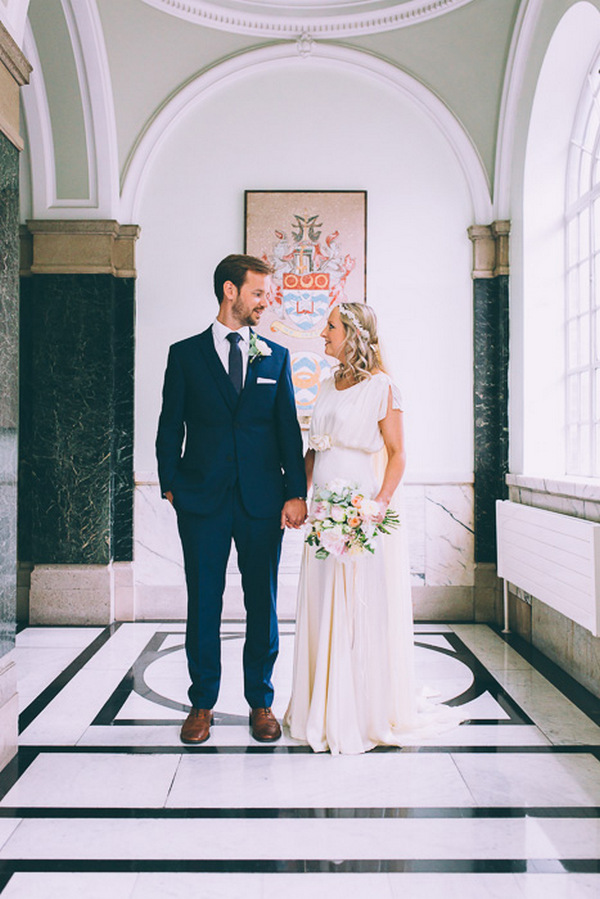 Bride and groom looking at each other in Islington Town Hall